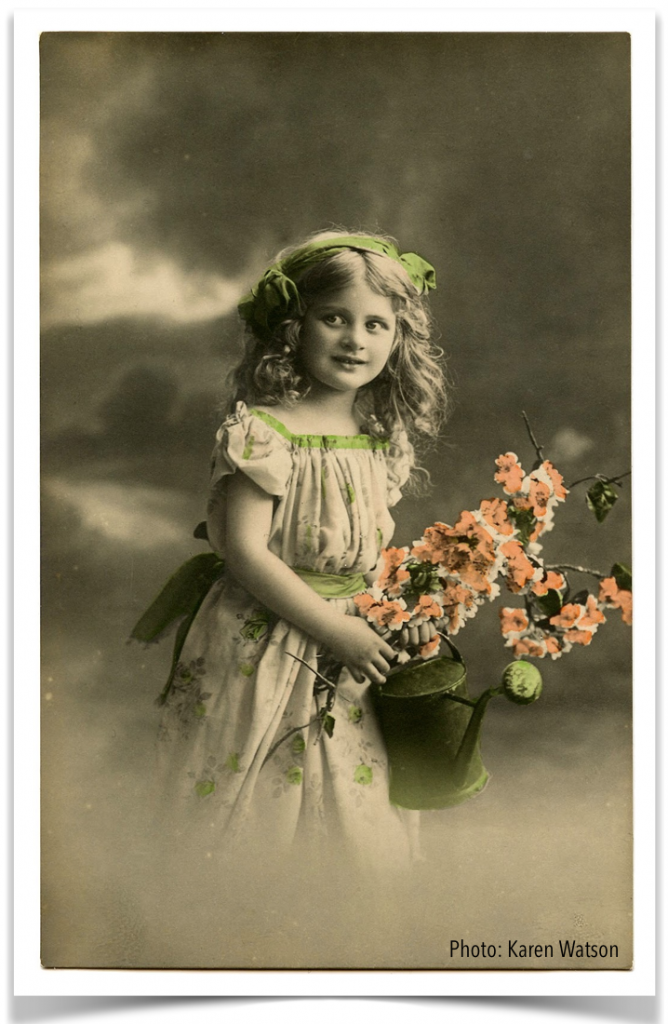 young girl with flowers vintage photo